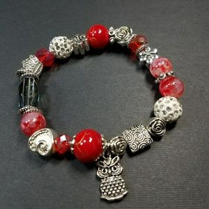 Red stretch bracelet with owl charm